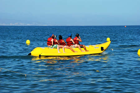Fuengirola, Spain - September 4, 2009 - Holidaymakers enjoying themselves on a banana boat, Torremolinos, Costa del Sol, Malaga Province, Andalucia, Spain  Éditoriale