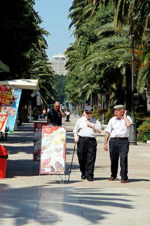 paseo: Malaga, Spain - June 14, 2011 - Old Spanish men walking along the Paseo del Parque, Malaga, Costa del Sol, Malaga Province, Andalucia, Spain, Western Europe