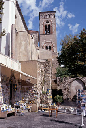 mementos: Ravello, Italy - Circa September, 1996 - Pottery shop and church bell tower in the town square, Ravello, Amalfi Coast, Campania, Italy, Western Europe  Editorial