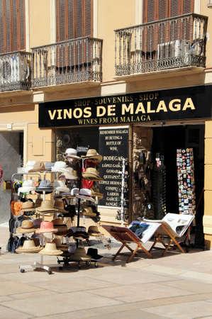 mementos: Malaga, Spain - June 14, 2011 - Hats for sale outside a wine shop, Malaga, Costa del Sol, Malaga Province, Andalucia, Spain, Western Europe