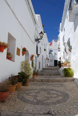 Townhouses along a typical whitewashed village street, Frigiliana, Malaga Province, Andalucia, Spain, Western Europe