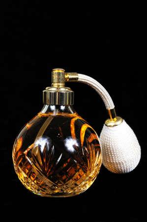 atomiser: Cut glass perfume atomiser bottle against a black background  Stock Photo