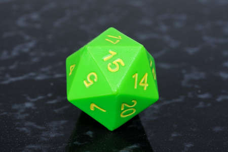 sided: Green icosahedron 20 sided shaped numbered die, England, UK, Western Europe
