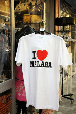 mementos: Malaga, Spain - June 14, 2011 - I love Malaga tee-shirt hanging outside a shop, Malaga, Costa del Sol, Malaga Province, Andalucia, Spain, Western Europe  Editorial