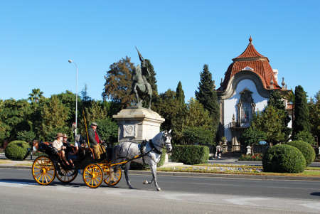 cid: Seville, Spain - November 15, 2008 - Portuguese Embassy on the Avenida del Cid at Glorieta San Diego with a horse drawn carriage in the foreground, Seville, Spain, Western Europe