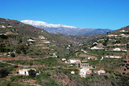 snow capped: Countryside near Arenas with the snow capped mountains to rear of Arenas, Spain Stock Photo