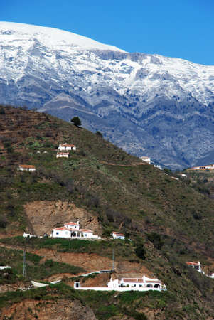 Countryside near Arenas with the snow capped mountains of the Sierra Almijara to rear of Arenas, Spain photo