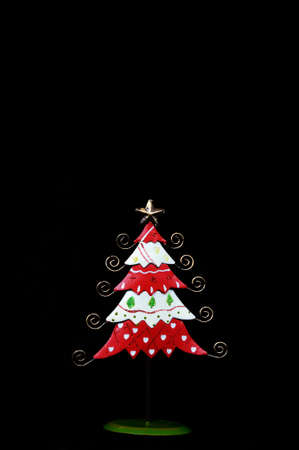 u k: Red and white Christmas tree against a black background