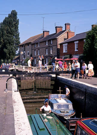 u lock: Stoke Bruerne, England - Circa August 1993 - Boats passing through the lock along the Grand Union canal at Stoke Bruerne, Northamptonshire, England, UK, Western Europe  Editorial