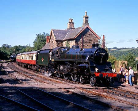 severn: Highley, UK - Circa July 1993 - British Railways Standard Class 4 4-6-0 leaving Highley station on the Severn Valley Railway, Highley, Shropshire, England, UK, Western Europe
