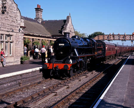 severn: Bridgnorth, United Kingdom - Circa July 1993 - Locomotive  LMS Stainer Mogul number 2968  along station platform, Severn Valley Railway, Bridgnorth, Shropshire, England, UK, Western Europe  Editorial