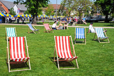 rsc: Stratford-upon-Avon, UK - May 18, 2014 - Colourful deckchairs in Bancroft gardens in front of the RSC, Stratford-Upon-Avon, Warwickshire, England, Western Europe  Editorial