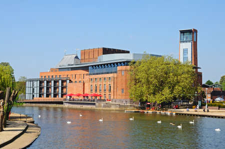Stratford-upon-Avon, United Kingdom - May 18, 2014 - Royal Shakespeare Company Theatre along the River Avon with swans in the foreground, Stratford-Upon-Avon, Warwickshire, England, United Kingdom, Western Europe