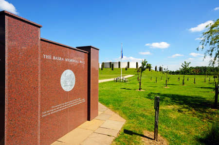 basra: Alrewas, United Kingdom - May 21, 2014 - Basra Memorial Wall with the Armed Forces Memorial to the rear, National Memorial Arboretum, Alrewas, Staffordshire, England, UK, Western Europe