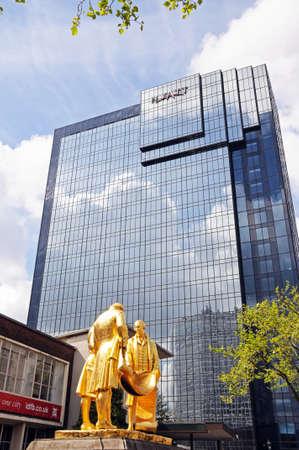 watt: Birmingham, United Kingdom - May 14, 2014 - Statue of Matthew Boulton, James Watt, and William Murdoch by William Bloye with the Hyatt Hotel to the rear, Broad Street, Birmingham, England, UK, Western Europe