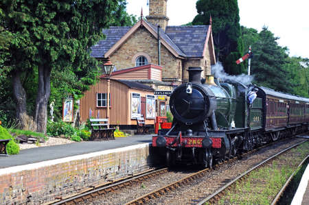 Hampton Loade - June 5, 2014 - Great Western Railways 2-8-0 heavy goods locomotive number 2857 pulling up alongside Great Western railway station platform, Hampton Loade, Shropshire, England, UK, Europe