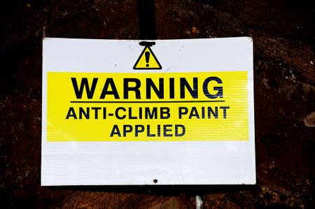 applied: Warning anti-climb paint applied sign