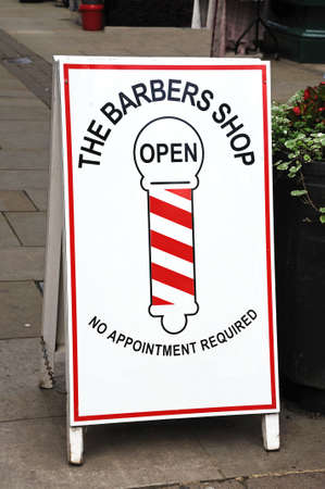 Traditional looking Barbers Shop sign on an A-board in the street, Leominster, Herefordshire, England, UK, Western Europe  Editorial