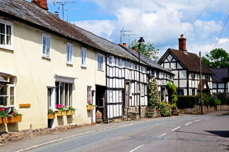 Traditional white timbered buildings along the East Street including the old post office, Pembridge, Herefordshire, England, UK, Western Europe  Stock Photo