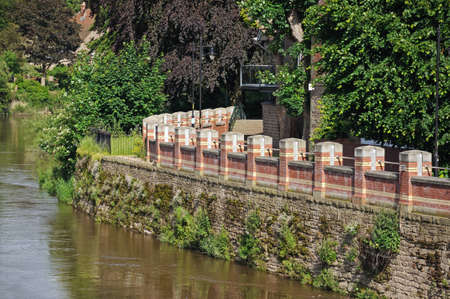 Hereford, United Kingdom - June 5, 2014 - Flood defence wall barrier along the River Wye, Hereford, Herefordshire, England, UK, Western Europe  Editorial