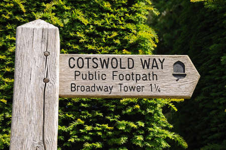 Wooden Cotswold Way signpost giving directions to Broadway Tower, Broadway, Cotswolds, Worcestershire, England, UK, Western Europe