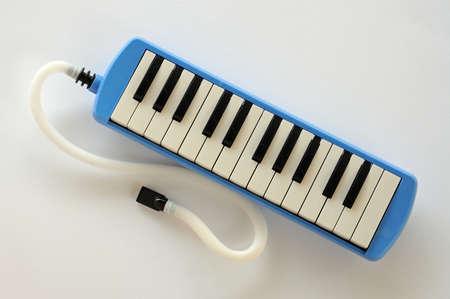 aerophone: Blue and white Pianica blow-organ