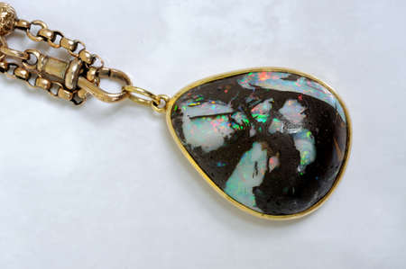opalescent: Wood opal pendant against a white background