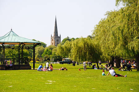 bandstand: Stratford-upon-Avon, UK - May 18, 2014 - Bandstand in Bancroft Gardens with the Holy Trinity Church spire to the rear, Stratford-Upon-Avon, Warwickshire, England, Western Europe  Editorial