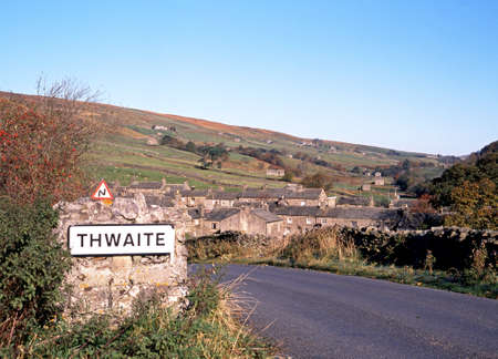 View of the village and surrounding countryside, Thwaite, Yorkshire Dales, North Yorkshire, England, UK, Great Britain, Western Europe  photo
