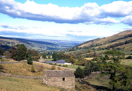 View of farmland and surrounding countrysidem in Wharfdale, Yorkshire Dales, England photo