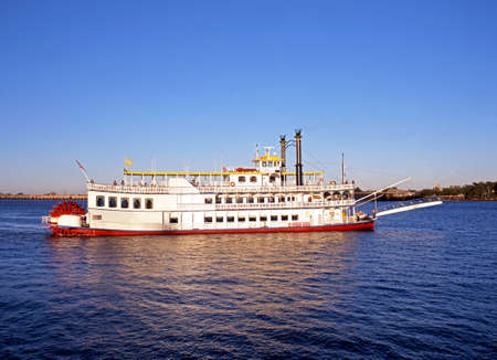 u.s. flag: Paddle steamer or Stern-Wheeler in Mississippi River, New Orleans, Louisiana, USA