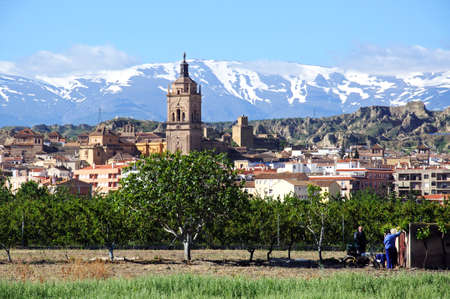 sierra snow: Guadix, Spain - May 5, 2010 - View of the town and Cathedral with the snow capped mountains of the Sierra Nevada to the rear, Guadix, Granada Province, Andalucia, Spain