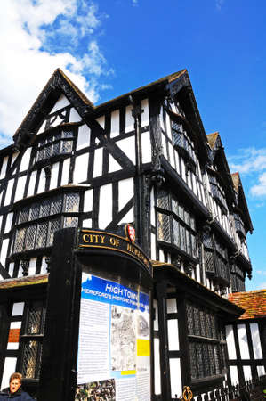 jacobean: Hereford- United Kingdom - June 5, 2014 - High House in High Town built in 1621 with an information sign in the foreground, Hereford, Herefordshire, England, UK, Western Europe