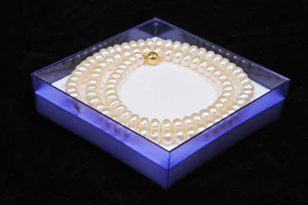 mementos: Cultivated pearl necklace in a blue translucent box