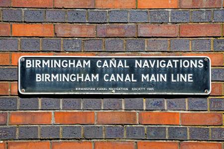 Birmingham, United Kingdom - May 14, 2014 - Birmingham Canal Main Line sign on a brick wall, Gas Street Canal Basin, Birmingham, West Midlands, England, UK, Western Europe