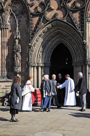 vicar: Lichfield, UK - March 9, 2014 - Clergymen greeting members of the congregation outside the Cathedral West Front door, Lichfield, Staffordshire, England, UK, Western Europe