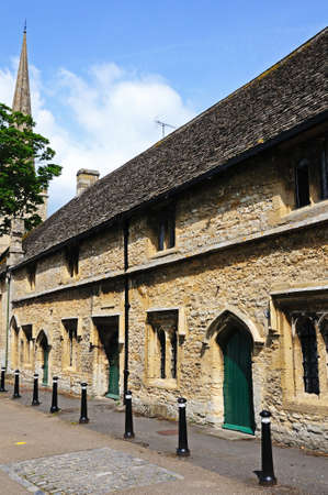 almshouse: Almshouses with St John the Baptist church to the rear, Burford, Oxfordshire, England, UK, Western Europe