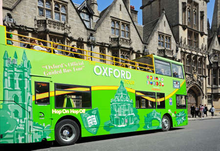 open topped: Green open topped Oxford tour bus along High Street, Oxford, Oxfordshire, England, UK, Western Europe