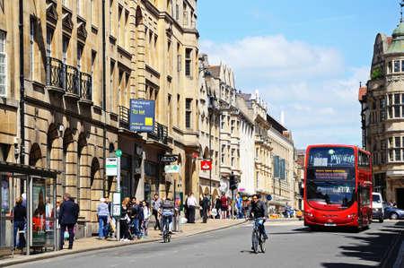 Oxford, UK - June 17, 2014 - Red electric-hybrid bus along St Aldates Street, Oxford, Oxfordshire, England, UK, Western Europe