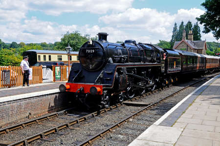 Arley, UK - July 10, 2014 - Steam Locomotive British Rail Standard Class 5 4-6-0 number 73129 in British Rail Black at the railway station, Severn Valley Railway, Arley, Worcestershire, England, UK, Western Europe