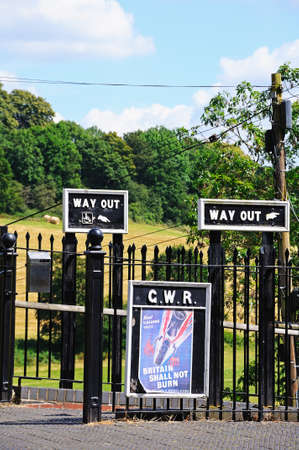 wartime: Highley, UK - July 10, 2014 - Old Retro way out signs and an old wartime poster, Severn Valley Railway, Highley, Worcestershire, England, UK, Western Europe