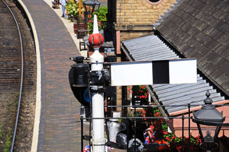 kwadrant: Great Western Railways lower quadrant semaphore signal in the stop danger position at the edge of the railway station, Severn Valley Railway, Arley, Worcestershire, England, UK, Western Europe