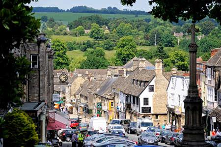 oxfordshire: Burford, UK - June 17, 2014 - Shops along the High Street, Burford, Oxfordshire, England, UK, Western Europe.