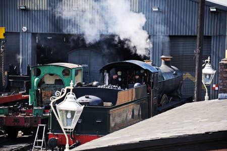 class maintenance: Bridgnorth, UK - July 10, 2014 - Steam Locomotive 7800 Class 4-6-0 Erlestoke Manor number 7812 in Great Western Railways green outside the engine shed, Severn Valley Railway, Bridgnorth, Shropshire, England, UK, Western Europe.