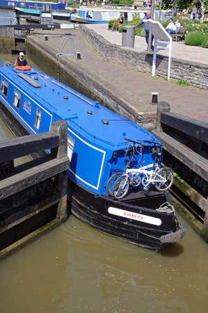 canal lock: Stratford-upon-Avon, UK - May 18, 2014 - Narrowboat in the canal lock, Stratford-Upon-Avon, Warwickshire, England, United Kingdom, Western Europe. Editorial