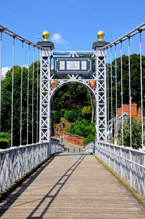 View across the River Dee Suspension Bridge aka Queens Park Suspension bridge, Chester, Cheshire, England, UK, Western Europe. photo