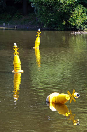 Yellow marker buoys along the River Dee, Chester, Cheshire, England, UK, Western Europe. photo