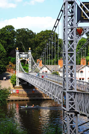 Chester, United Kingdom - July 22, 2014 - River Dee Suspension Bridge aka Queens Park Suspension bridge along the River Dee, Chester, Cheshire, England, UK, Western Europe.