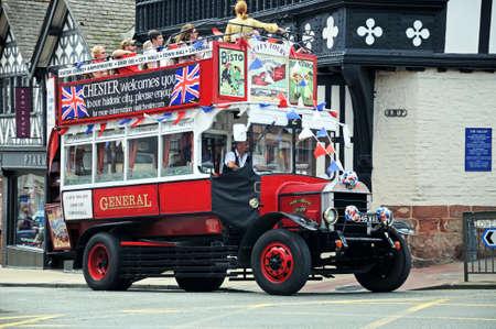 open topped: Chester, UK - July 22, 2014 - Tour bus on corner of Bridge Street and Grosvenor Street, Chester, Cheshire, England, UK, Western Europe.