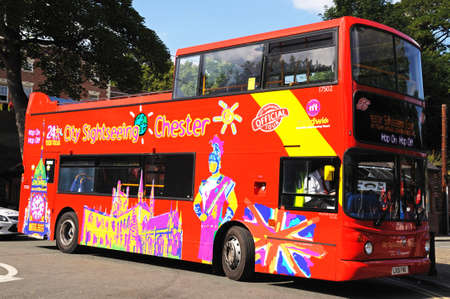 open topped: Chester, UK - July 22, 2014 - Tour bus on the roundabout at the bottom of Souter